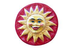 Ceramic adornment Red sun smiles Stock Photos