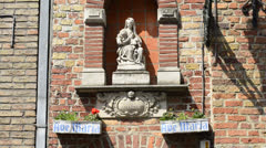 Madonna and child statue on the wall of the building in Bruges, Belgium Stock Footage