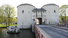 Medieval Kruispoort gates and the bridge over canal Stock Footage