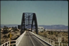charter bus driving over bridge to Kansas City in summer, circa 1940 to 1950 - stock footage
