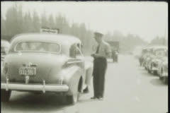 U.S. and Canadian Border patrol passport check 1940s, 8mm film Stock Footage