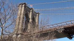 US flag over Brooklyn Bridge, NYC Stock Footage