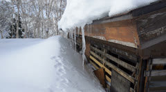 Small ski hut on the snowy slopes Stock Footage