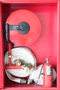 firefighting equipment in the cabinet. - stock photo