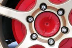 gold alloy wheel. - stock photo
