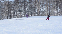 Skiers and Snowboarders Stock Footage