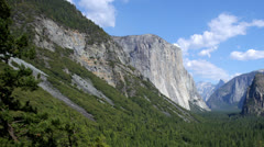 Time lapse of blue skies and fluffy white clouds over Yosemite National Park Stock Footage
