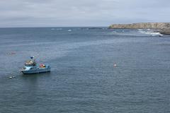 Fishing boat off ocean coast of California Stock Photos