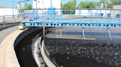 Sewage treatment plant. Waste water treatment - circular sedimentation tank Stock Footage
