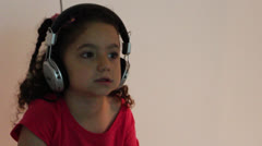 Stock Video Footage of Young girl listen to music