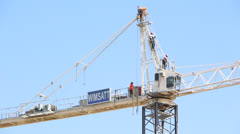Rigging Crew Atop Construction Crane Stock Footage