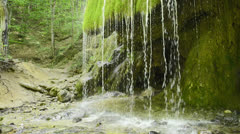 Grotto under a waterfall Stock Footage