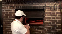 Cooking pizza in the oven Stock Footage
