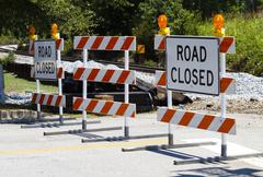 Road Closed Barricades at a Railroad Crossing - stock photo