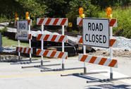 Stock Photo of Road Closed Barricades at a Railroad Crossing