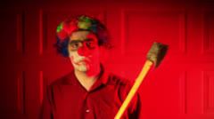 Weird clown ax axe creepy Stock Footage