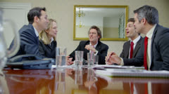 Mature group of business people in a boardroom meeting Stock Footage