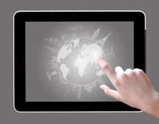 Hand touch on tablet pc to drawing travel around the world Stock Illustration