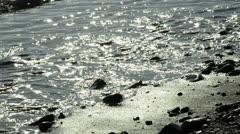 Ocean waves at sone beach, backlit Stock Footage
