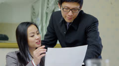 Young Asian business partners in a meeting, discuss their business strategy Stock Footage