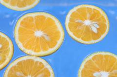 oranges in water - stock photo