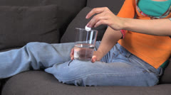 Jeans woman with effervescent medicine 60 Stock Footage