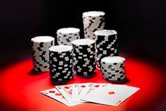 Poker, royal flush and gambling chips. - stock photo