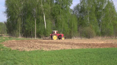 Agriculture tractor plowing spring farm field Stock Footage