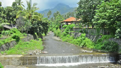 Drain chanel/ storm sewer in Bali Indonesia with waterfall of the last rain Stock Footage