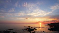 timelapse sunset with clouds over sea - stock footage