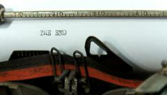 Typing a text on an old typewriter: The End Stock Footage