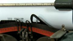 Typing a text on an old typewriter: TOP SECRET Stock Footage