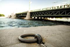 Mooring ring on stone embankment of the Neva river. Stock Photos