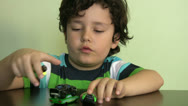 Stock Video Footage of Boy plays with his  toy cars