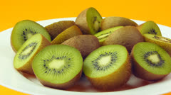 Halves an kiwi fruits on a white plate. Stock Footage