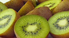 Halves an kiwi fruits closeup Stock Footage