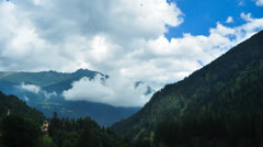 Mountains with clouds time lapse Stock Footage