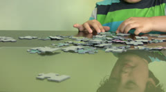 Child solving a puzzle Stock Footage