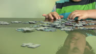 Stock Video Footage of Child solving a puzzle