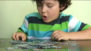 Stock Video Footage of Little boy solving puzzle