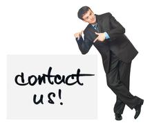 Young businessman points on a card contact us on a white Stock Photos