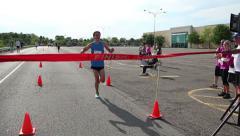 Stock Video Footage of Marathon Finish Line Winner