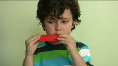 Child with harmonica Stock Footage