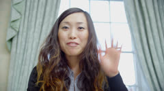 Young Asian businesswoman makes a video call - stock footage