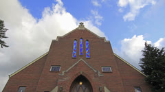 White Clouds Moving over Church with Crucifix and Stained Glass Timelapse Stock Footage