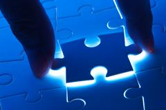 pick puzzle piece with mystery light - stock photo