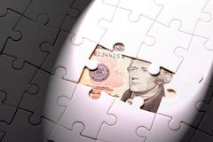 find out wealth from the puzzle game - stock photo