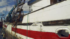 Old Fishing Boat at Harbor - Starboard Amidships Stock Footage