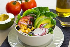 Avocado with Corn and Olive salad Stock Photos