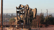 Stock Video Footage of Oil Drill in the late afternoon sun